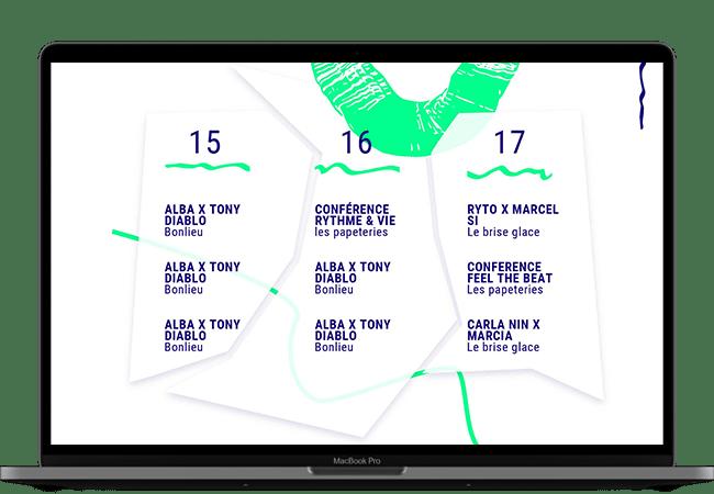 Photo d'un ordinateur. Dans l'écran, on voit la partie programme du site, avec les événements qui ont lieu chaque jour du festival.