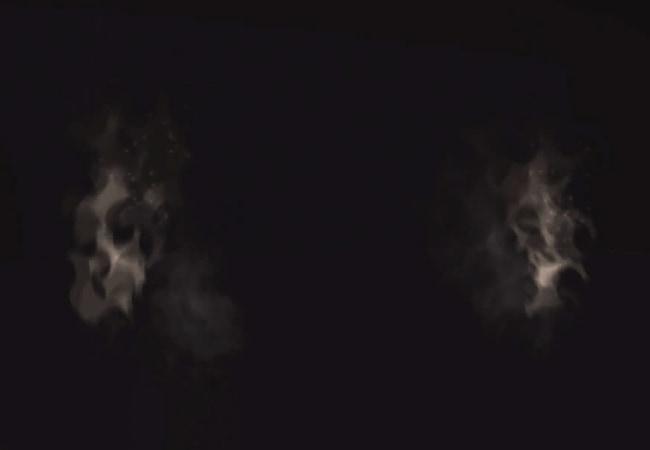 Image abstraite extraite de l'expérience Act. Sur fond noir, on distingue 2 flammes grises sur la droite et la gauche.