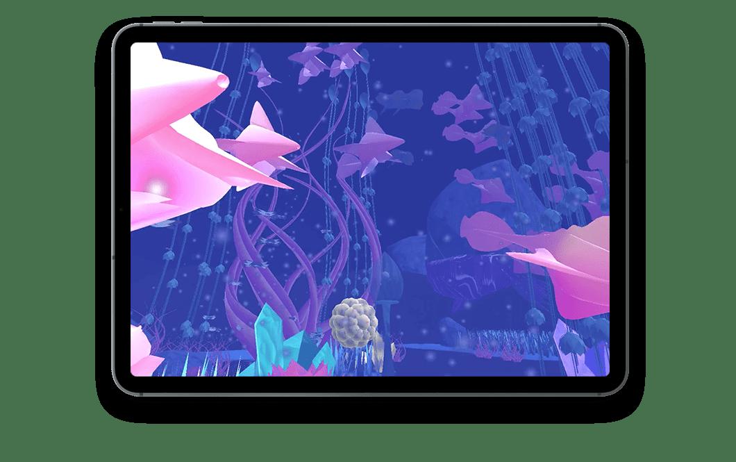 Tablette avec vue sur l'écran. Dans l'écran, on voit le monde d'Abyss, un monde sous-marin fantastique, fond bleu, poissons roses et diverses plantes aquatiques