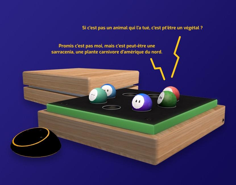 Sur fond bleu foncé, des vues 3D de l'objet Oo'ly. On voit un boitier en bois, carré, séparé en 2 parties dans la hauteur. La partie du haut est un couvercle pour fermer le boîtier, la partie du bas est un plateau noir, avec 8 encoches en cercle pour placer les Oo', un bouton On, et des boutons de volume sonore. A côté du boitier, on voit une sorte de télécommande noir, ronde et plate. Il s'agit du Pod. On aperçoit des boutons sur la surface du dessus. En jaune, il est écrit au dessus de deux Oo', comme s'ils dialoguaient