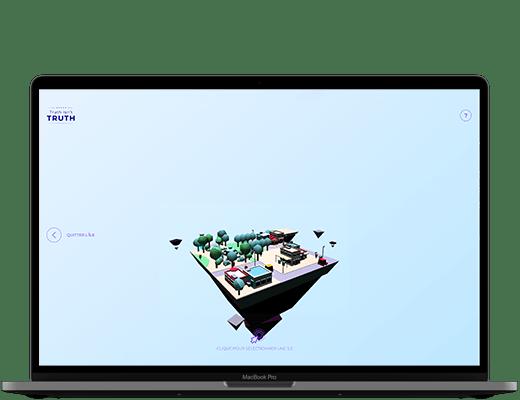 Photographie d'un ordinateur. Dans l'écran, on peut voir la scène 3D du site truth isn't Truth, avec le premier îlot, celui des USA, flottant dans un ciel bleu.